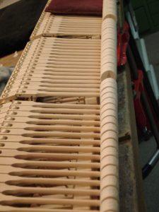 Ligne de marteaux de mécanique de piano à queue